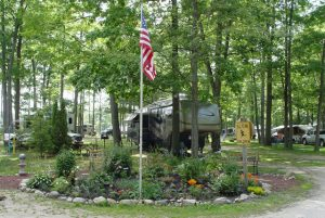 Our flower garden welcoming campers to their campsites